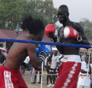 Pal Kuol in red gloves times Nicholas Muthoka from Kenya